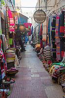 Essaouira, Morocco.  Baskets, Fabrics, Wall Hangings Line the Street in the Medina.
