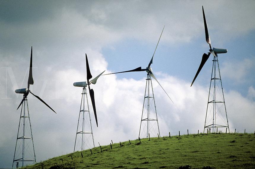 Modern windmills against a cloudy sky