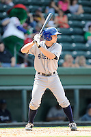 Second baseman Michael Benjamin (18) of the Asheville Tourists bats in a game against the Greenville Drive on Sunday, July 20, 2014, at Fluor Field at the West End in Greenville, South Carolina. Asheville won game one of a doubleheader, 3-1. (Tom Priddy/Four Seam Images)