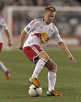 New York Red Bulls midfielder Dax McCarty (11) dribbles. Despite a red-card man advantage, in a Major League Soccer (MLS) match, the New England Revolution tied New York Red Bulls, 1-1, at Gillette Stadium on September 22, 2012.