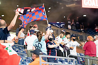 FOXBOROUGH, MA - MAY 22: New England Revolution fans react to a goal during a game between New York Red Bulls and New England Revolution at Gillette Stadium on May 22, 2021 in Foxborough, Massachusetts.