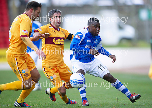 St Johnstone v Motherwell...03.11.12      SPL.Nigel Hasselbaink turns Keith Lasley.Picture by Graeme Hart..Copyright Perthshire Picture Agency.Tel: 01738 623350  Mobile: 07990 594431