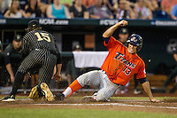 Cal State Fullerton Titans shortstop Timmy Richards (13) slides safely under the tag from Vanderbilt Commodores pitcher Carson Fulmer (15) during the NCAA College baseball World Series on June 14, 2015 at TD Ameritrade Park in Omaha, Nebraska. The Titans were leading 3-0 in the bottom of the sixth inning when the game was suspended by rain. (Andrew Woolley/Four Seam Images)