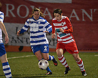 20140221 - OOSTAKKER , BELGIUM : Antwerp Charlotte Andries (r) pictured with Gent Nina Vindevoghel (l) during the soccer match between the women teams of AA Gent Ladies  and RAFC Antwerp Ladies , on the 19th matchday of the BeNeleague competition Friday 21 February 2014 in Oostakker. PHOTO DAVID CATRY