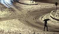 Pictured: A lone walker walks in the snow in Larissa, central Greece Thursday 12 January 2017<br /> Re: Heavy snow has affected most parts of Greece.