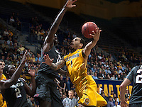 Justin Cobbs of California in action during 2014 National Invitation Tournament against Arkansas at Haas Pavilion in Berkeley, California on March 24th, 2014.  California defeated Arkansas, 75-64.