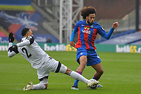 Jaïro Riedewald of Crystal Palace battles with Kenny Tete of Fulham during the Premier League behind closed doors match between Crystal Palace and Fulham at Selhurst Park, London, England on 28 February 2021. Photo by Vince Mignott / PRiME Media Images.