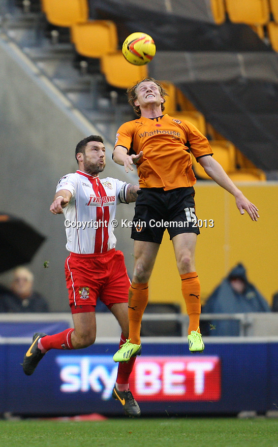 Bjorn Sigurdarson of Wolves beats Jon Ashton of Stevenage to a header<br />  - Wolverhampton Wanderers v Stevenage - Sky Bet League One - Molineux, Wolverhampton - 2nd November 2013. <br /> © Kevin Coleman 2013