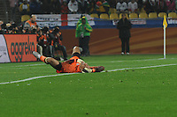 U.S. goalkeeper Tim Howard writhes in pain after a hard collision with England forward Emile Heskey. The U.S. and England played to a 1-1 draw in the opening match of Group C play at Rustenburg's Royal Bafokeng Stadium, Saturday, June 12th.