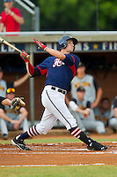Dykota Spiess #14 (Western Carolina) of the High Point-Thomasville HiToms follows through on his swing against the Wilson Tobs at Finch Field on June 17, 2013 in Thomasville, North Carolina.  The Tobs defeated the HiToms 3-2 in 11 innings.  Brian Westerholt/Four Seam Images