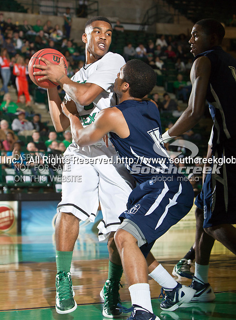 North Texas Mean Green guard Chris Jones (5) in action during the game between the Jackson State Tigers and the University of North Texas Mean Green at the North Texas Coliseum,the Super Pit, in Denton, Texas. UNT defeated Jackson State 69 to 55...