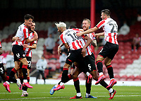 Brentford players congratulate Ethan Pinnock after scoring their second goal during Brentford vs Charlton Athletic, Sky Bet EFL Championship Football at Griffin Park on 7th July 2020