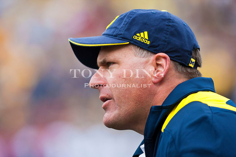 Michigan head coach Rich Rodriguez shouts from the sidelines in the fourth quarter of an NCAA college football game with Connecticut, Saturday, Sept. 4, 2010, in Ann Arbor. Michigan won 30-10. (AP Photo/Tony Ding)