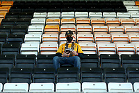 8th September 2020; Abbey Stadium, Cambridge, Cambridgeshire, England; EFL Trophy Football, Cambridge United versus Fulham Under 21; A Cambridge Utd fan sits socially distance in the stand
