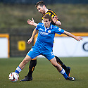Queen of the South's Daniel Carmichael holds off Alloa's Ben Gordon.