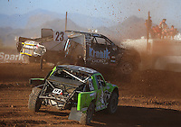 Apr 17, 2011; Surprise, AZ USA; LOORRS driver John Gaston (23) and Nick Tyree (91) during round 4 at Speedworld Off Road Park. Mandatory Credit: Mark J. Rebilas-