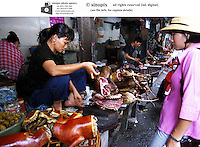 A market sells dog meat in Hanoi, Vietnam. Dogs meat is considered a delicacy in Vietnam with increasing numbers being illegally stolen and shipped across the border from Thailand.