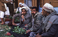 Yemen Sana'a,.Qut market, tradesman sitted and chewing qat,  a plant that contains the alkaloid cathinone, a stimulant, which is said to cause excitement