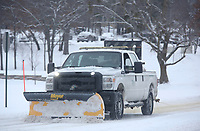 A city of Fayetteville Transportation Department truck continues to treat and clear snow and ice Wednesday, February 17, 2021, on Razorback Road in Fayetteville. The National Weather Service forecasts partly sunny skies with a high near 28 degrees today. Check out nwaonline.com/210218Daily/ and nwadg.com/photos for a photo gallery.<br /> (NWA Democrat-Gazette/David Gottschalk)
