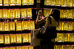 A visitor takes a picture to the lanterns during the annual ''Mitama Festival'' at Yasukuni Shrine on July, 13, 2015, Tokyo, Japan. Over 30,000 lanterns line the entrance to the shrine to help spirits find their way during the annual celebration for the spirits of ancestors. The festival is held from July 13th to 16th. (Photo by Rodrigo Reyes Marin/AFLO)
