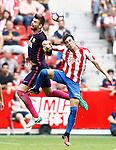 Sporting de Gijon's Burgui (r) and FC Barcelona's Gerard Pique during La Liga match. September 24,2016. (ALTERPHOTOS/Acero)