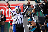 Jacksonville Jaguars Ben Koyack (83) spikes the ball after catching a touchdown pass from Blake Bortles (not shown) in the third quarter during an NFL Wild-Card football game against the Buffalo Bills, Sunday, January 7, 2018, in Jacksonville, Fla.  (Mike Janes Photography)