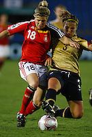 Svenja Huth (GER) and Amber Brooks (USA) compete for the ball..FIFA U17 Women's World Cup, Semi Final, Germany v USA, QEII Stadium, Christchurch, New Zealand, Thursday 13 November 2008. Photo: Renee McKay/PHOTOSPORT