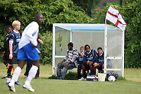 Members of New North Rangers FC look on as an England flag flies from the dugout during the East London Advertiser Sunday Cup Final at Ive Farm Arena, Leyton - 25/05/08 - MANDATORY CREDIT: Gavin Ellis/TGSPHOTO - Self billing applies where appropriate - Tel: 0845 094 6026