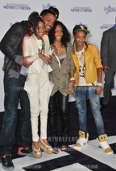 """Will Smith & wife Jada Pinkett Smith & children Jaden & Willow at the Los Angeles premiere of """"Justin Bieber: Never Say Never"""" at the Nokia Theatre LA Live..February 8, 2011  Los Angeles, CA.Picture: Paul Smith / Featureflash"""