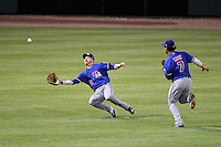 Round Rock Express outfielder Doug Deeds #17 attempts to catch a fly ball as Luis Cruz #7 backs him up during a game versus the Memphis Redbirds at Autozone Park on April 29, 2011 in Memphis, Tennessee.  Round Rock defeated Memphis by the score of 5-4 in 13 innings.  Photo By Mike Janes/Four Seam Images