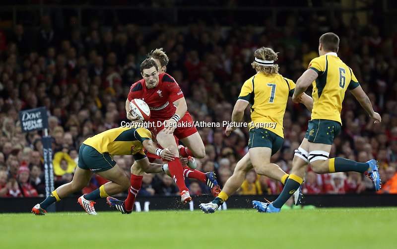 Pictured: George North of Wales (with ball) avoids a tackle. Saturday 08 November 2014<br /> Re: Dove Men Series rugby, Wales v Australia at the Millennium Stadium, Cardiff, south Wales, UK.