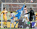 13/02/2010  Copyright  Pic : James Stewart.sct_jspa16_hamilton_v_motherwell  .::  JOHN RUDDY TIPS THE BALL AWAY FROM THE HEAD OF MARK MCLAUGHLIN ::.James Stewart Photography 19 Carronlea Drive, Falkirk. FK2 8DN      Vat Reg No. 607 6932 25.Telephone      : +44 (0)1324 570291 .Mobile              : +44 (0)7721 416997.E-mail  :  jim@jspa.co.uk.If you require further information then contact Jim Stewart on any of the numbers above.........