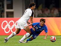 USWNT midfielder (7) Shannon Boxx fouls Japanese forward (11) Shinobu Ohno while playing at Qinhuangdao Stadium. The US defeated Japan, 1-0, during first round play at the 2008 Beijing Olympics in Qinhuangdao, China.