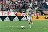 FOXBOROUGH, MA - JULY 25: Joel Waterman #16 of CF Montreal brings the ball forward during a game between CF Montreal and New England Revolution at Gillette Stadium on July 25, 2021 in Foxborough, Massachusetts.