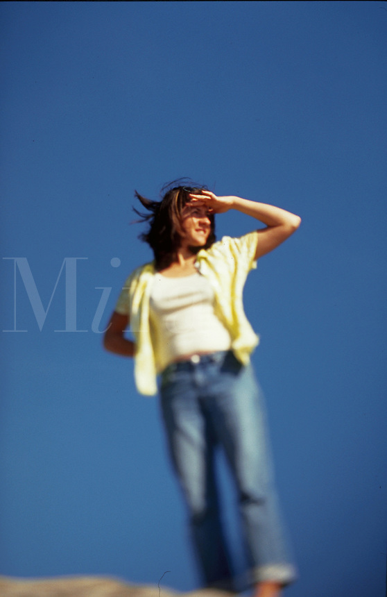 Blurred image of a woman looking out into the distance.