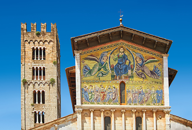Close up of the campinale & Facade with Byzantine Mosaic panel depicting Christ Pantocrator of the Basilica of San Frediano, a Romanesque church, Lucca, Tunscany, Italy