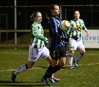 20131213 - VARSENARE , BELGIUM : Brugge's Nicky Van Den Abbeele (right) pictured with Zwolle's  Sylvia Smit (left) in her back during the female soccer match between Club Brugge Vrouwen and PEC Zwolle Ladies , of  matchday 14  in the BENELEAGUE competition. Friday 13th December 2013. PHOTO DAVID CATRY