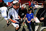 Leigh RMI 0, FC United of Manchester 0, 16/07/2005. Hilton Park, pre-season friendly. A visiting player signing an autograph for a fan. FC United of Manchester (in red) were established by dissident Manchester United supporters in the wake of the Malcolm Glazer takeover of their club. They were admitted to the North West Counties League prior to the 2005-06. Photo by Colin McPherson.
