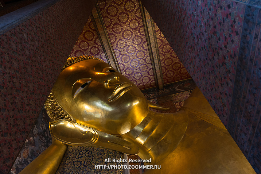 Face of Buddha in the Temple Of The Reclining Buddha, Bangkok, Thailand