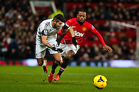Saturday 11 January 2014 Pictured: Alejandro Pozuelo clashes with Patrice Evra <br /> Re: Barclays Premier League Manchester Utd v Swansea City FC  at Old Trafford, Manchester