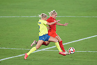 YOKOHAMA, JAPAN - AUGUST 6: Jonna Andersson #2 of Sweden battles for the ball with Adriana Leon #9 of Canada during a game between Canada and Sweden at International Stadium Yokohama on August 6, 2021 in Yokohama, Japan.