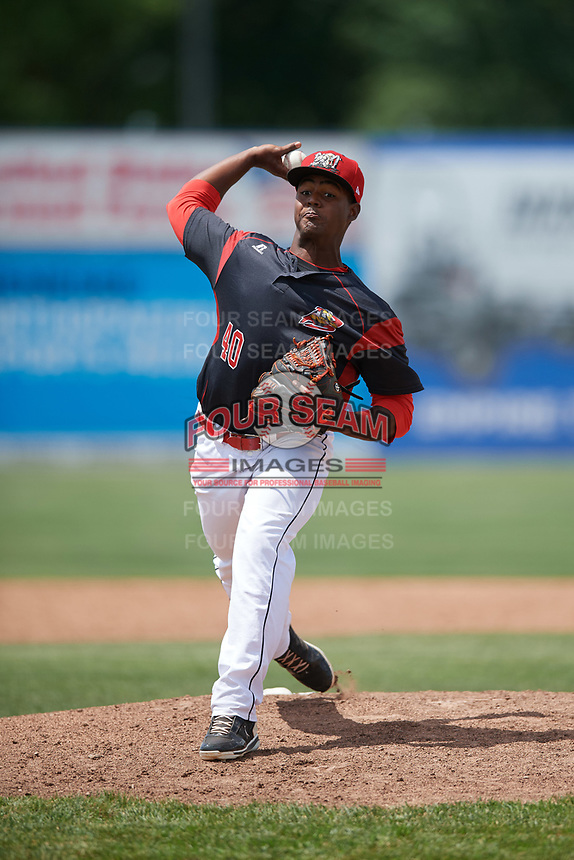 Batavia Muckdogs relief pitcher Eliezer Cuello (40) delivers a warmup pitch during a game against the West Virginia Black Bears on June 25, 2017 at Dwyer Stadium in Batavia, New York.  West Virginia defeated Batavia 6-4 in the completion of the game started on June 24th.  (Mike Janes/Four Seam Images)