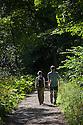 Walkers in Water-cum-Jolly Dale, Peak District National Park, Derbyshire, UK. August. Model Released.