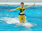 """April 26, 2017, Yokohama, Japan - Shiori Tamai, a member of Japanese girls only pop group """"Momoiro Clover Z"""" (MCZ) rides on the back of a white beluga at the aquarium of the Hakkeijima Sea Paradise in Yokohama, suburban Tokyo on Wednesday, April 26, 2017. The aquarium will start the new attraction with sea aninals featuring a MCZ's TV program for children from April 28.   (Photo by Yoshio Tsunoda/AFLO) LwX -ytd-"""