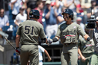 Vanderbilt Commodores third baseman Austin Martin (16) celebrates with teammate JJ Bleday (51) after his leadoff home run in Game 3 of the NCAA College World Series against the Louisville Cardinals on June 16, 2019 at TD Ameritrade Park in Omaha, Nebraska. Vanderbilt defeated Louisville 3-1. (Andrew Woolley/Four Seam Images)
