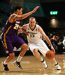 Reno Bighorns Blake Ahearn drives past Los Angeles D-Fenders' Gerald Green duruing a basketball game in Reno, Nev., on Friday, Jan. 6, 2012. The D-Fenders won 109-78..Photo by Cathleen Allison