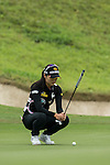 Ji Hyun Oh of South Korea putts on the green during Round 2 of the World Ladies Championship 2016 on 11 March 2016 at Mission Hills Olazabal Golf Course in Dongguan, China. Photo by Lucas Schifres / Power Sport Images