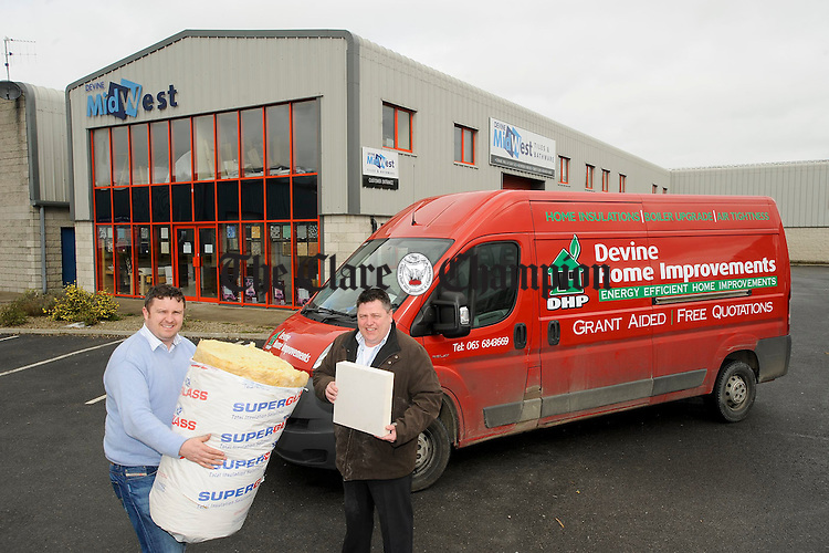 Declan Moroney and Danny Devine of Devine Home Improvements, Energy Effecient Home Improvements outside the parent company Devine Mid West Tiles in the Quin  Road Business Park. Photograph by John Kelly.
