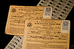 War Ration Books photographed using WW II Navy Captain's uniform as background.  Photo's show both sides and ration stamps.