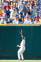 South Carolina's Jackie Bradley Jr. makes a catch in Game 10 of the NCAA Division One Men's College World Series on June 24th, 2010 at Johnny Rosenblatt Stadium in Omaha, Nebraska.  (Photo by Andrew Woolley / Four Seam Images)